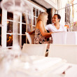 Couple in Outdoor Restaurant — Stock Photo #5706780