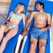 Pool Lounge Chair Couple — Stock Photo #5706825