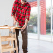 Man Sanding Boards - Stock Photo