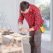 Man Using Electric Hand Sander — Stock Photo