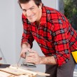 Man with Electric Hand Sander - Stock Photo