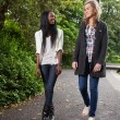Women enjoying walk in park — Stock Photo