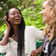 Cheerful women enjoying chat in the park — Stock Photo