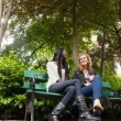 Relaxed female friends chatting in the park — Stock Photo