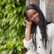 Young African American woman standing and smiling — Stock Photo