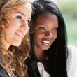 Happy young females looking away — Stock Photo