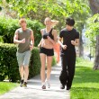 Royalty-Free Stock Photo: Friends jogging together in a park