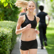 Portrait of a woman jogging - Stock Photo