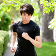 Serious man jogging - Stockfoto
