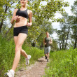 Friends jogging in a forest — Stock Photo #5709127