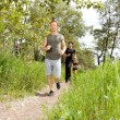 Friends exercising in forest track — Stock Photo