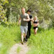 Stock Photo: Friends jogging in forest