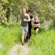 Friends jogging in the forest — Stock Photo #5709321