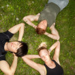 Stock Photo: Friends lying down and resting