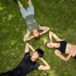 Friends lying and resting on ground — Stock Photo