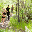 Friends running in the forest — Stock Photo