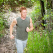Young man jogging — Stock Photo