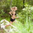 Woman running in the forest — Stock Photo #5709993