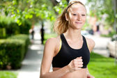 Beautiful woman jogging — Stok fotoğraf
