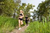 Tři běžící na stáž — Stock fotografie
