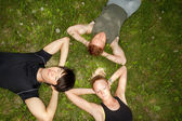 Friends lying down and resting — Stockfoto