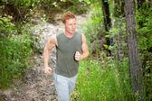 Young man jogging — Stock Photo