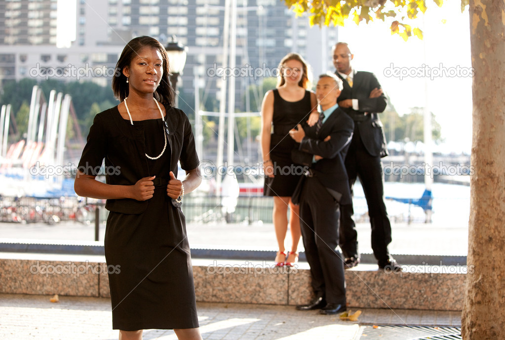 An African American woman in front of a business team — Stock Photo #5702719