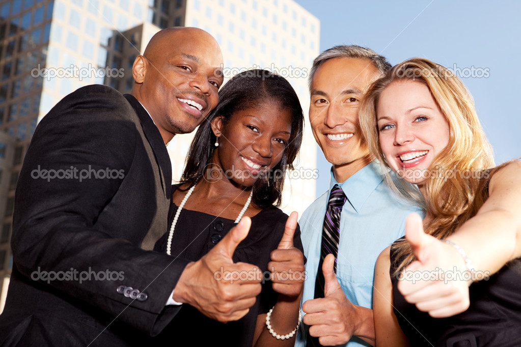 A group of business giving a thumbs up sign — Stock Photo #5702969