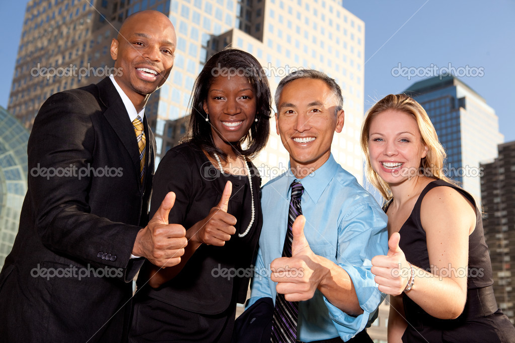 A group of business giving a thumbs up sign  Stock Photo #5703011