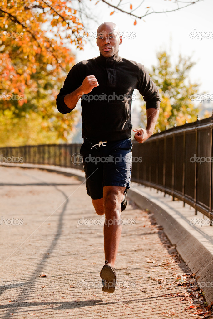 An African American jogging in a park in the morning  Stock Photo #5703048
