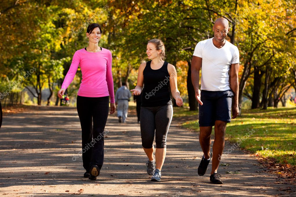 Three walking in a park, getting some exercise — Stock Photo #5703093
