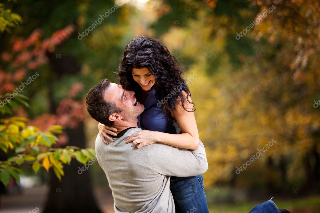An excited couple giving eachother a big hug in a park — Stock Photo #5705235
