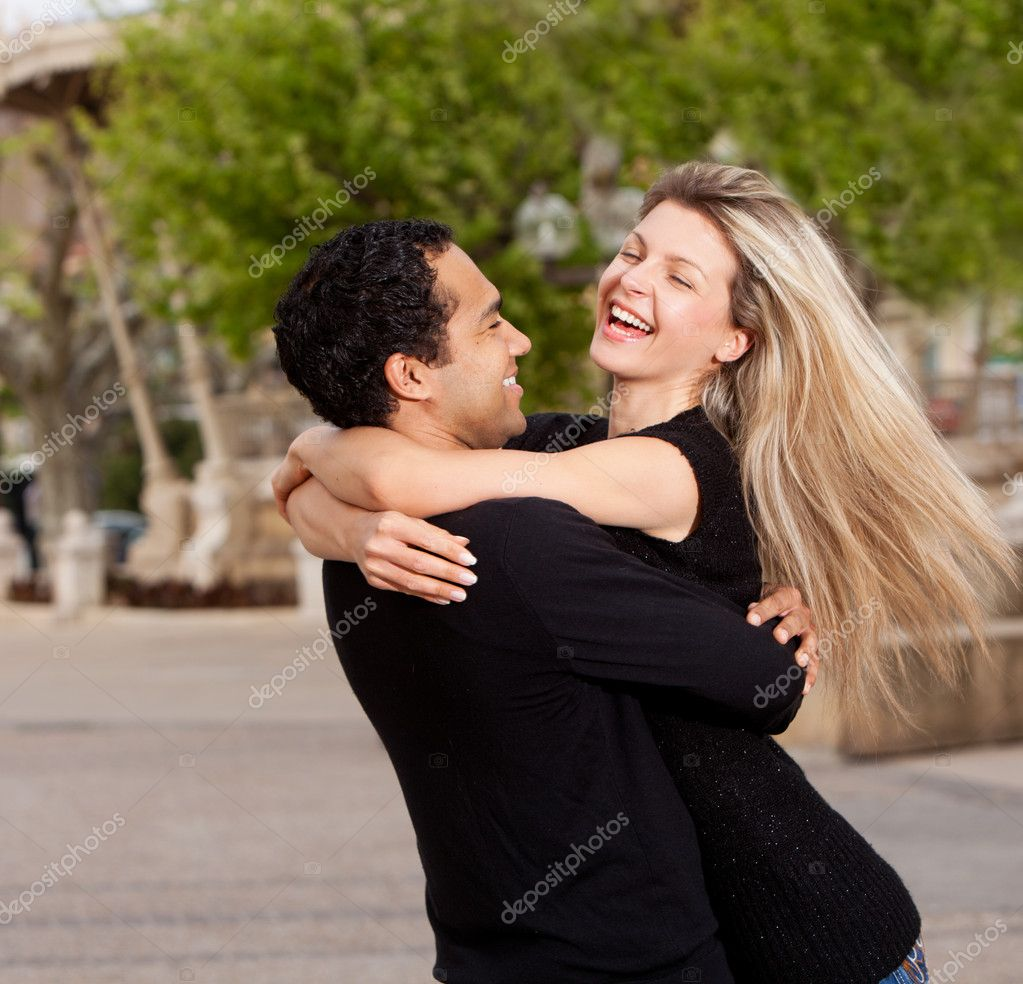 A happy playful couple in an urban setting — Stock Photo #5706204
