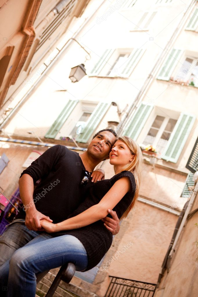 A happy french couple in a small quaint street  Photo #5706419