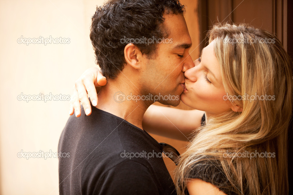 A couple kissing outdoors in an European urban setting — Stock Photo #5706476