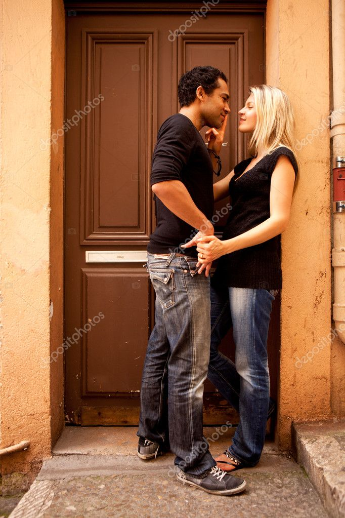 An attractive couple flirting in an outdoor European setting — Stock Photo #5706488