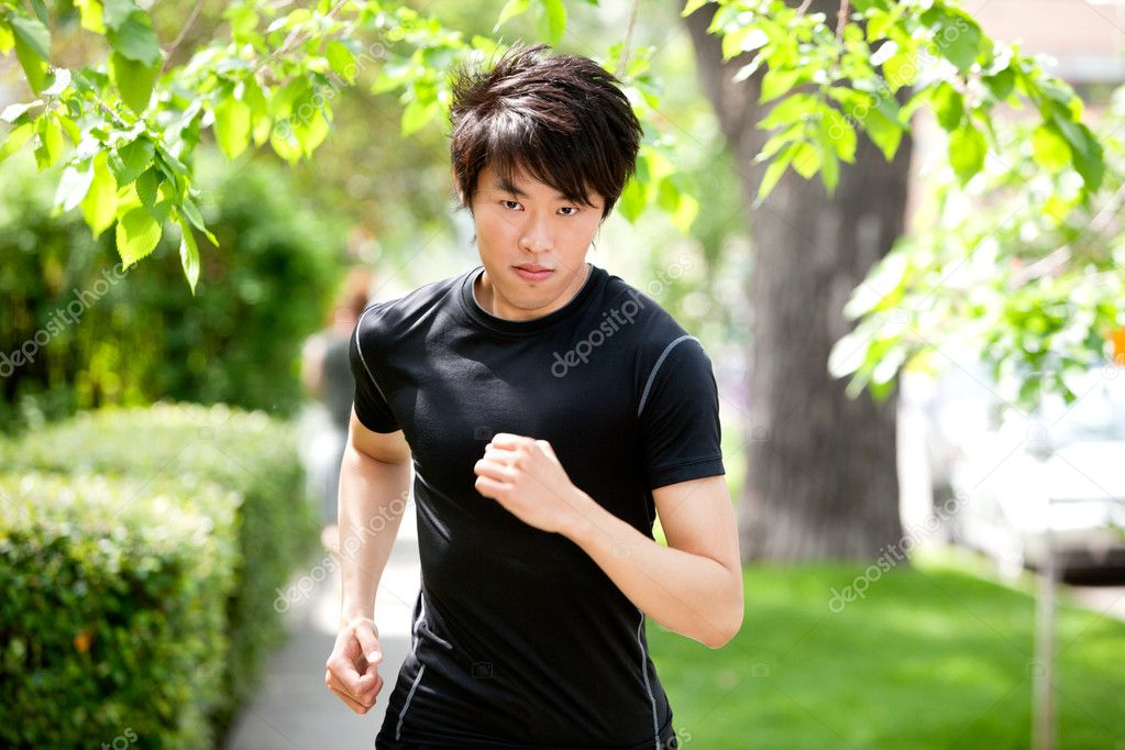 Portrait of a handsome serious man jogging in a park  Stock Photo #5708961