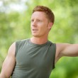 Man smiling and looking away — Stock Photo