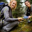Finding a Geocache - Stock Photo
