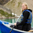Woman Canoeing on Lake — Stock Photo