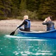 Canoe Adventure in Lake - Stock Photo