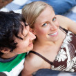 Stock Photo: Young couple relaxing on picnic blanket