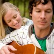 Outdoor Guitar Couple - Stock Photo