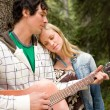 Stock Photo: MPlaying Guitar Outdoor