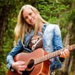 Hippy Woman with Guitar — Stock Photo #5711135