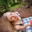Blond woman eating watermelon while picnic — Stock Photo #5711157
