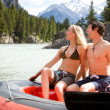Man and Woman Rafting - Stock Photo