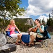Camping Couple with Guitar - Stockfoto