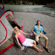 Stock Photo: Couple Relaxing while Camping