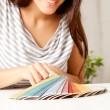 Woman looking at Color Swatches — Stock Photo